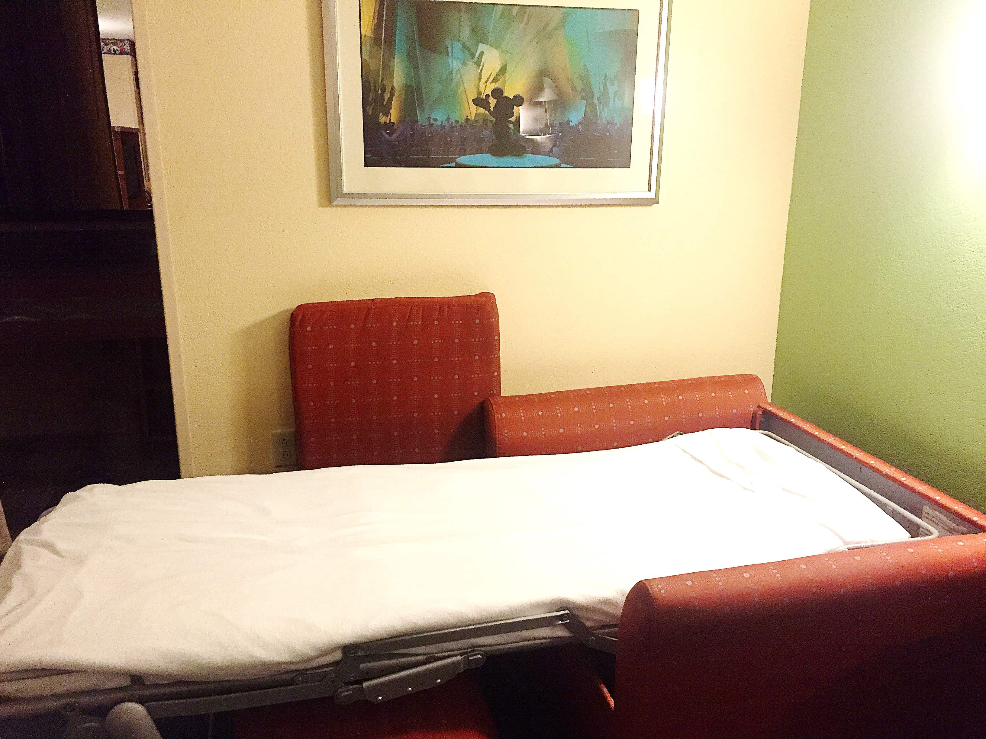 A view of the chair sleeper in an All-Star Music Disney Family Suite