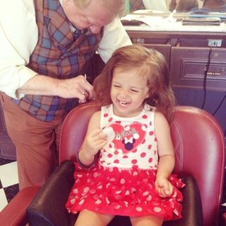 Disney World with Toddlers is perfect for a first Disney haircut at Harmony Barbershop.