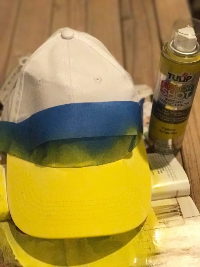 Using fabric spray paint to make a Daisy Duck hat.