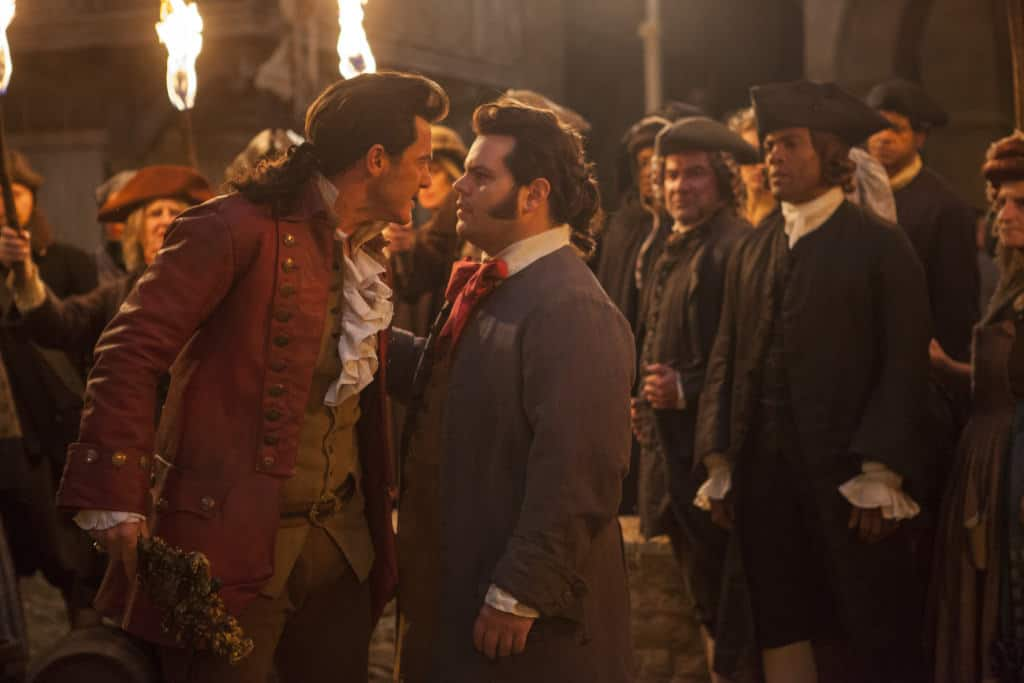 Luke Evans and Josh Gad as Gaston and LeFou in Beauty and the Beast
