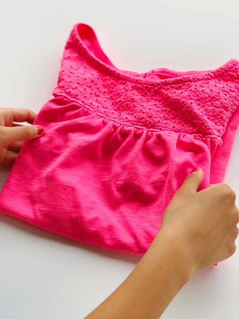 Teach your kids how to do laundry by letting them fold and have fun with it!