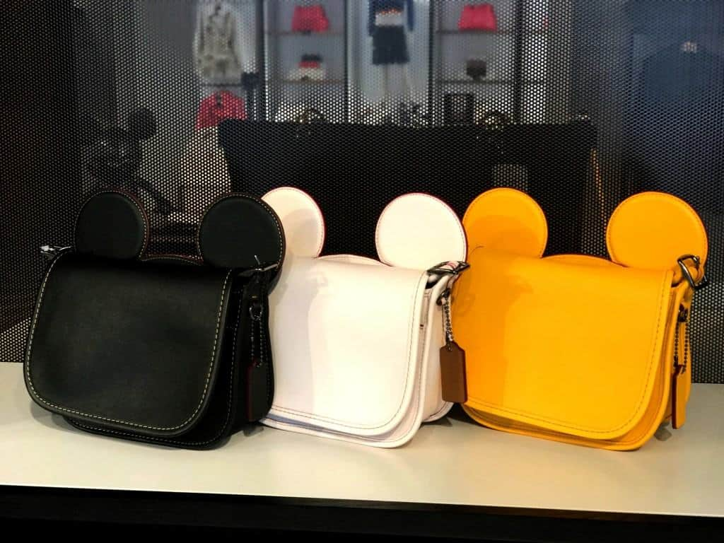 The Mickey Head purses are adorable at the Disney Coach Outlet.