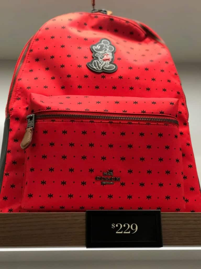 The most expensive backpack at the Disney Coach Outlet is this red backpack.