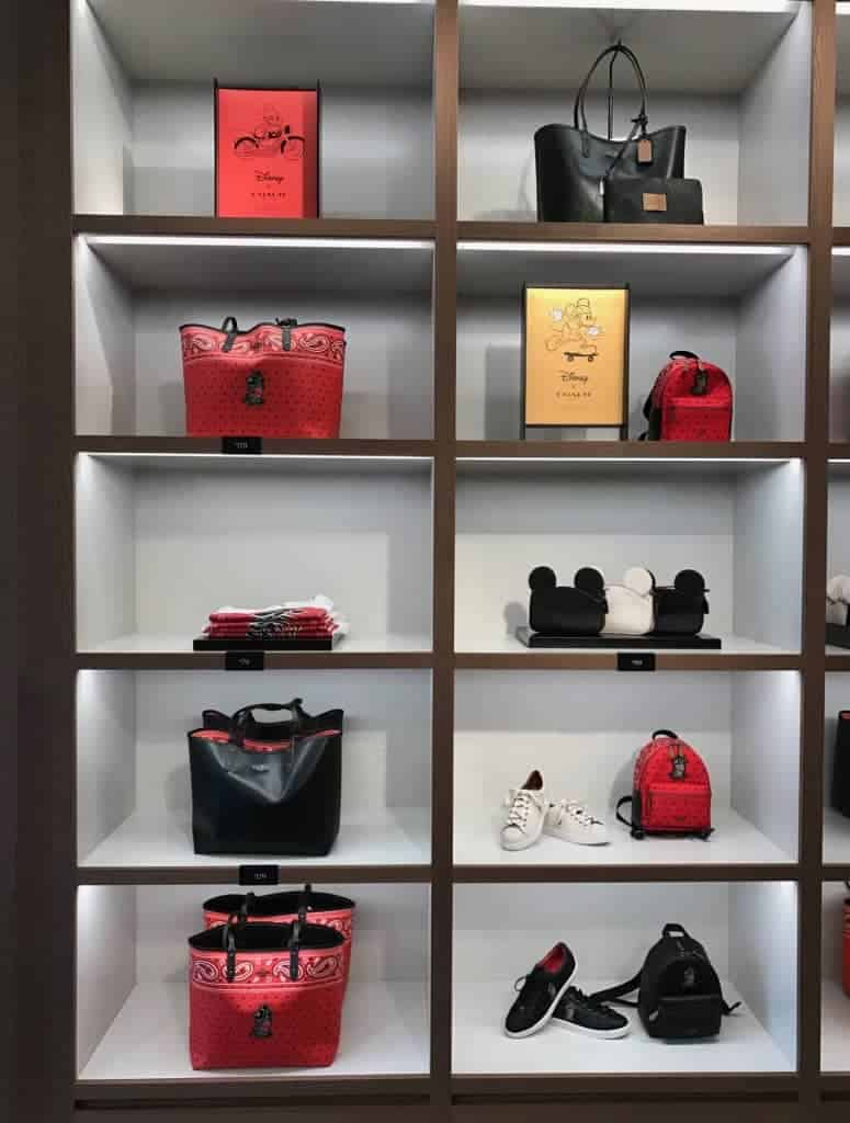 You can find backpacks, shoes, purses, wristlets, and more at the Disney Coach Outlet!