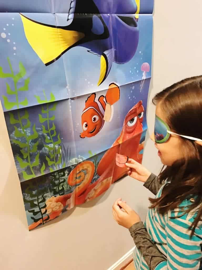 A fun Finding Dory party game is pin-the-fin-on-Nemo.