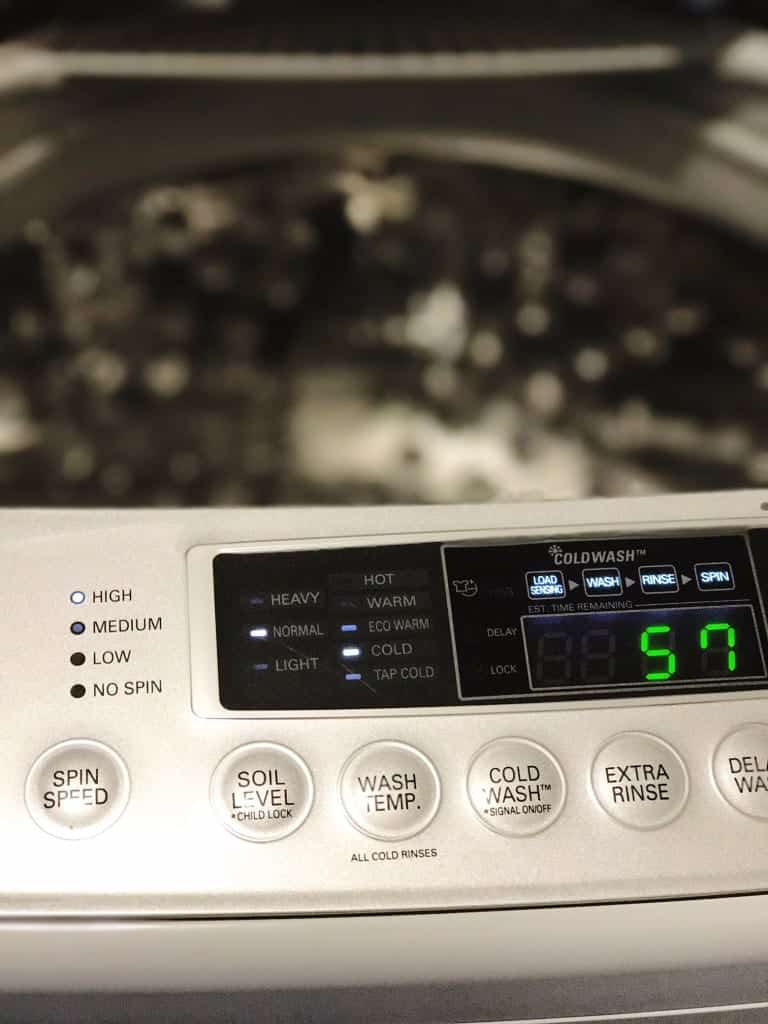You can change your general settings on your washing machine to wash clothes in cold water instead of hot water.