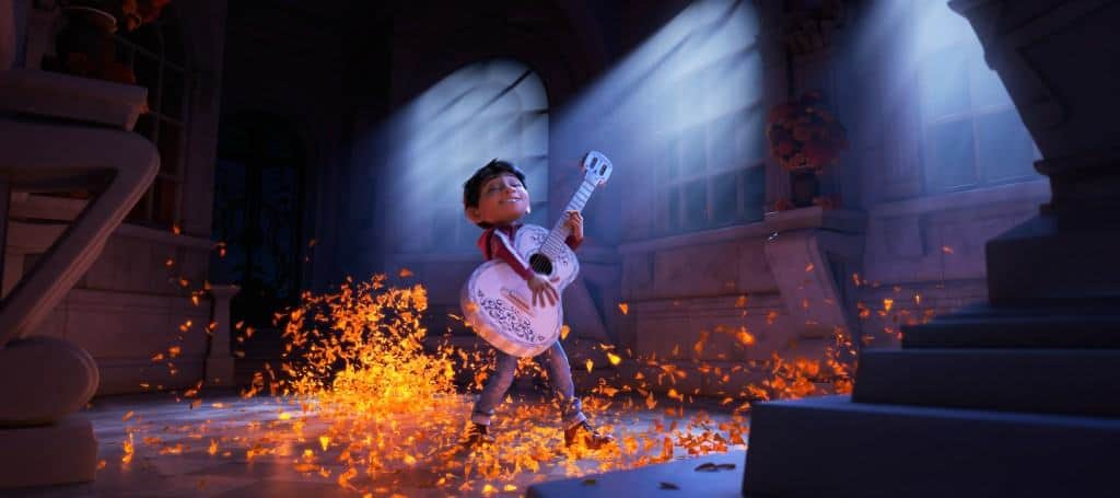 In the movie Coco, Miguel wants to play music like his favorite musician and finds a new land!