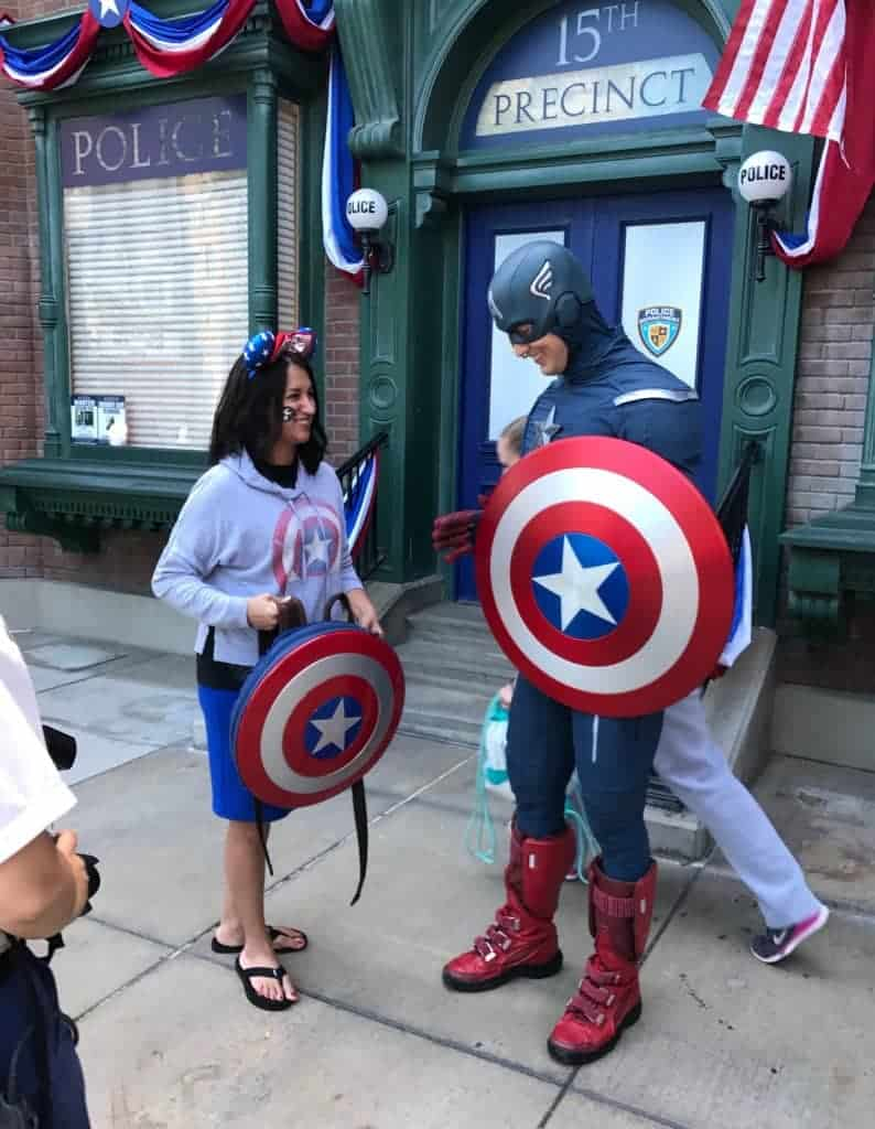 I did not even notice the woman running behind me and Captain America!