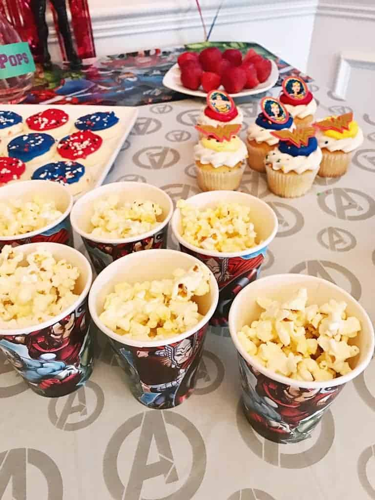 An easy superhero party idea is to buy premade cupcakes and add rings or toys to the frosting to decorate them!