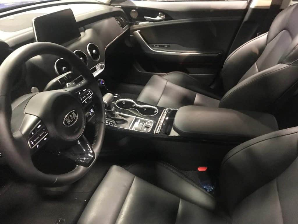 At the Washington Auto Show, sit inside cars and feel the leather.