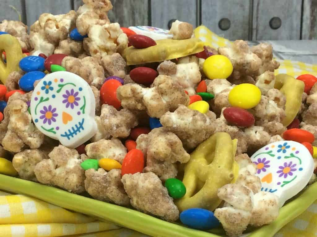 Throw a Pixar Coco Party and make this delicious Churro Popcorn!