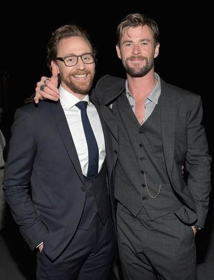Tom Hiddleston and Chris Hemsworth pose together for the Avengers Infinity War Red Carpet
