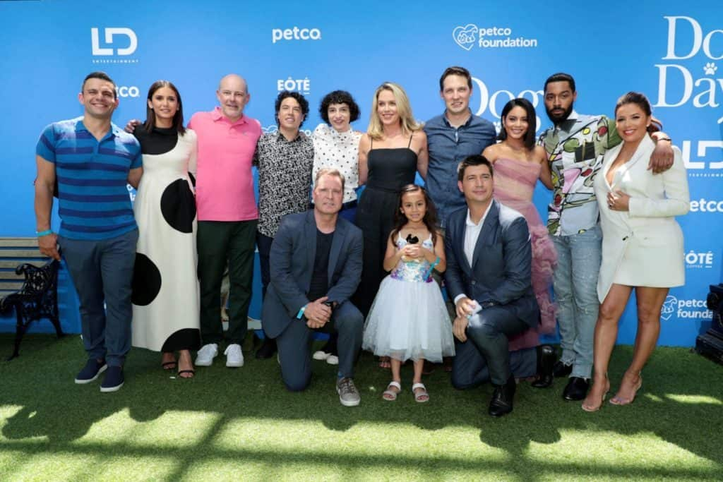 The cast of Dog Days walk the green carpet at the Dog Days Premiere.