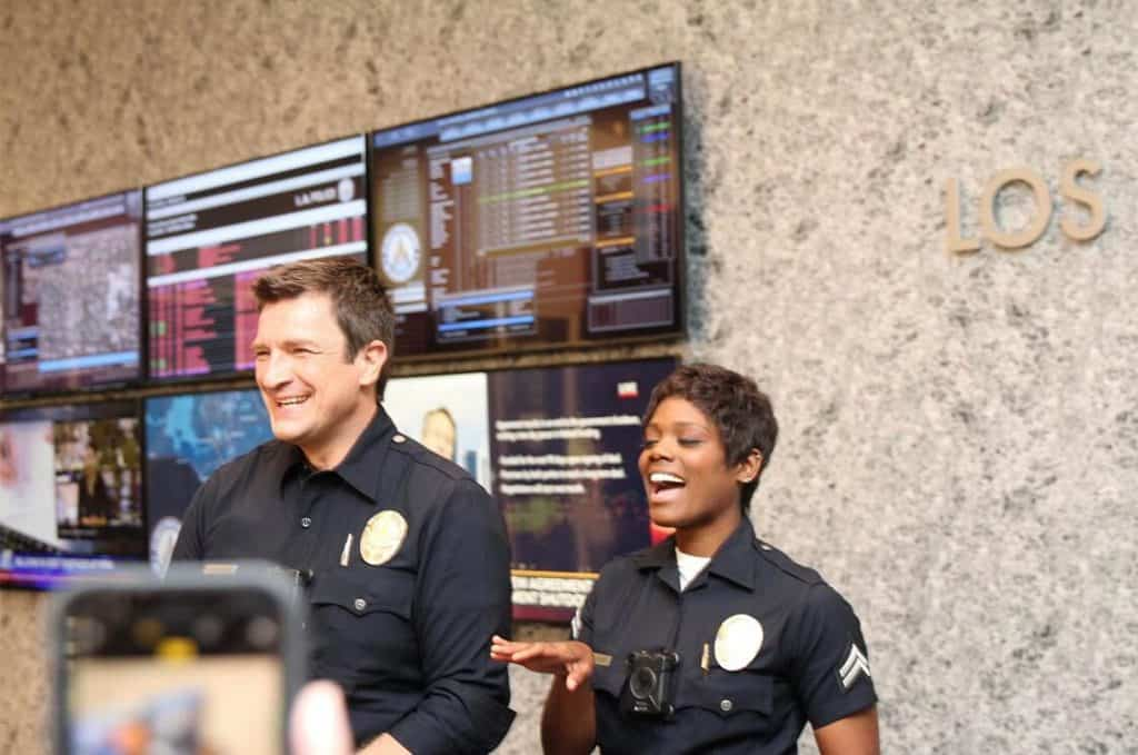 Nathan Fillion and Afton Williamson on the set of The Rookie